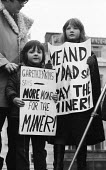 Miners and supporters protest, miners strike 1972 London for increased pay - Mike Tull - 1970s,1972,activist,activists,against,boy,boys,CAMPAIGN,campaigner,campaigners,CAMPAIGNING,CAMPAIGNS,child,CHILDHOOD,children,cities,City,DAD,DADDIES,DADDY,DADS,DEMONSTRATING,Demonstration,DEMONSTRATI