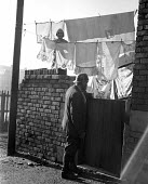 Miner at the end of his shift, Horden Colliery, County Durham, 1948 his wife hanging her washing out to dry in the back yard - Elisabeth Chat - 01-06-1948