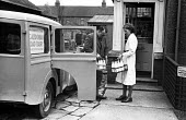 Milk delivery by Caledonian Dairies to a local shop 1948, Peterlee, County Durham - Elisabeth Chat - 1940s,1948,Austin,bottle,bottles,Caledonian Dairies,corner shop,corner store,County Durham,deliver,deliveries,delivering,delivery,distributing,distribution,EARNINGS,EBF,Economic,Economy,employee,emplo