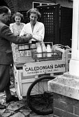 Wholesale milk delivery by The Caledonian Dairy to a local shop 1948, Peterlee, County Durham - Elisabeth Chat - 1940s,1948,barrow,bottle,bottles,Caledonian Dairy,County Durham,Dairy,deliver,deliveries,delivering,delivery,distributing,distribution,EARNINGS,EBF,Economic,Economy,employee,employees,Employment,house