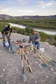 Big Bend National Park, Texas USA Mexicans with handicrafts for tourists to buy, overlooking the Rio Grande. American immigration authorities threaten to prosecute buyers because the items are brought... - Jim West - 04-11-2017