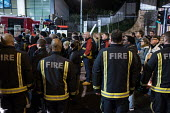 Firefighters stand in respect, Justice for Grenfell silent walk, Kensington and Chelsea, London - Philip Wolmuth - 14-11-2017