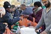 Homeless and hungry queuing for food, Coventry. The soup kitchen and food bank is provided by The Midland Langar Seva Society - John Harris - 05-11-2017