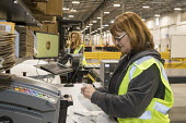 Romulus Michigan USA Workers prepare labels for UPS shipments, Mopar auto parts distribution centre. Mopar is the auto parts operation of Fiat Chrysler Automobiles - Jim West - 06-12-2017