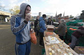 Homeless and hungry queuing for food, Coventry. The soup kitchen and food bank is provided by The Midland Langar Seva Society. Eating cake. - John Harris - 05-11-2017