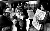 Baby Food Action Group protest, Nestle HQ, Croydon 1975 calling for Nestle to stop advertising milk powder around the world as substituting artificial breastmilk for breast feeding leads to malnutriti... - John Sturrock - 1970s,1975,activist,activists,adult,adults,advertising,babies,baby,baby food,Baby Milk Action,breast feeding,Breastmilk Substitutes,campaign,campaigning,CAMPAIGNS,capitalism,child,CHILDHOOD,children,D