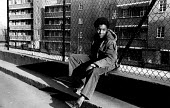 Young black teenage boy hanging around after school with nothing to do, Hillrise Mansions estate North London 1973 - John Sturrock - 03-03-1977