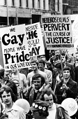 Gay Pride march 1977 for equal rights for homosexuals London - John Sturrock - 1970s,1977,activist,activists,Campaign for Homosexual Equality,CAMPAIGNING,CAMPAIGNS,CHE,DEMONSTRATING,DEMONSTRATION,DEMONSTRATIONS,equal,equality,Gay,Gay Pride,Gays,Haringey,heterosexuals. celebratin