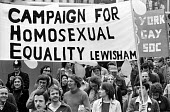 Gay Pride march protesting for equal rights for homosexuals London 1977 - John Sturrock - 1970s,1977,activist,activists,banner,banners,Campaign for Homosexual Equality,CAMPAIGNING,CAMPAIGNS,CELEBRATE,celebrating,CHE,DEMONSTRATING,Demonstration,DEMONSTRATIONS,equal,equality,Gay,Gay Pride,Ga