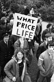 Trade union protest against public service cuts London 1977 - John Sturrock - 1970s,1977,activist,activists,against,anti,CAMPAIGNING,CAMPAIGNS,cuts,DEMONSTRATING,Demonstration,FBU,FEMALE,London,male,man,member,member members,members,men,people,person,persons,placard,placards,Pr