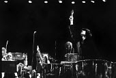 Stomu Yamashta playing percussion The Tedious Path To The House of Natasha Ungeheuer, Olympic Theatre Rome 1971. Premiere of Hans Werner Henze political manifesto music with German text by Gustav Salv... - Arno Hammacher - 17-05-1971