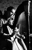 Actress Diana Rigg playing the harp in her London apartment 1963 - Alex Low - 29-03-1963