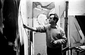 Adrian Heath in his studio, London 1958, painter and writer of Abstract Painting Its Origin And Meaning - Alan Vines - 1950s,1958,abstract,abstract art,ACE,Adrian Heath,art,artist,artists,arts,artwork,artworks,cities,City,culture,London,male,man,men,modern,modernism,modernist,modernists,paint,painter,painters,painting