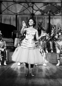 Elizabeth Julius singing 1959 Golden City Dixies from Pretoria, South Africa performing on stage, London, tour of Britain - Alan Vines - 1950s,1959,ACE,Africa,BAME,BAMEs,band,bands,black,BME,bmes,cities,City,costume,costumes,dance,DANCER,DANCERS,dancing,diversity,Elizabeth Julius,entertainment,ethnicity,FEMALE,Golden City Dixies,London