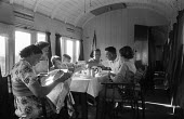 Devon 1959 holidaymakers eating breakfast in disused train carriages converted for holiday use - Alan Vines - 13-08-1959