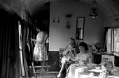 Devon 1959 holidaymakers relaxing after breakfast in disused train carriages converted for holiday use - Alan Vines - 13-08-1959