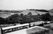 Devon 1959 holidaymakers talking outside their Camping Coaches, disused train carriages converted for holiday use, Loddiswell near Kingsbridge - Alan Vines - 13-08-1959