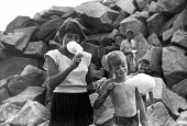 Devon 1959 children eating candy floss at the seaside on their summer holiday - Alan Vines - 13-08-1959