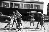 Devon 1959 family on summer holiday leaving their Camping Coaches, disused train carriages converted for holiday use, for the nearby beach - Alan Vines - 13-08-1959