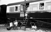 British holidaymakers on their annual summer vacation at their Camping Coaches - disused train carriages converted for holiday use Loddiswell near Kingsbridge in Devon 1959 - Alan Vines - 13-08-1959