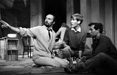 Director John Dexter (L) talking to Playwright Arnold Wesker (R), rehearsal of The Kitchen by Arnold Wesker, The Theatre Upstairs at the Royal Court London 1959 Actor Christopher Sandford is sitting b... - Alan Vines - 1950s,1959,ACE,acting,actor,actors,adult,adults,Arnold Wesker,Arts,author,authors,Christopher Sandford,communicating,communication,conversation,Court,Culture,Dexter,dialogue,directing,director,directo