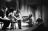 Theatre Director John Dexter in discussion with actors rehearsal of The Kitchen by Arnold Wesker, The Theatre Upstairs at the Royal Court London 1959 - Alan Vines - 1950s,1959,ACE,acting,actor,actors,adult,adults,Arnold Wesker,Arts,author,authors,communicating,communication,conversation,conversations,Court,Culture,Dexter,dialogue,directing,director,directors,disc
