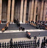 State Funeral of Sir Winston Churchill St Pauls Cathedral London 1965 Churchillss coffin is carried from the Cathedral after the Funeral Service with his wife Clementine and his son Randolph following... - Bert Hardy - 1960s,1965,armed forces,Belief,casket,Cathedral,CATHEDRALS,ceremonial,ceremonies,ceremony,christian,christianity,christians,Church of England,cities,City,cofe,coffin,conviction,cortege,DEATH,DEATHS,di