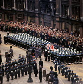 State Funeral of Sir Winston Churchill St Pauls Cathedral London 1965 Churchillss coffin is placed on a gun carriage outside the Cathedral after the Funeral Service for the next stage of its journey - Bert Hardy - 1960s,1965,armed forces,Belief,carriage,CARRIAGES,casket,Cathedral,CATHEDRALS,ceremonial,ceremonies,ceremony,christian,christianity,christians,Church of England,cities,City,cofe,coffin,conviction,cort
