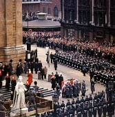 State Funeral of Sir Winston Churchill St Pauls Cathedral London 1965 Massed crowds watch as Churchillss coffin is carried into the Cathedral for the Funeral Service - Bert Hardy - 1960s,1965,armed forces,Belief,casket,Cathedral,CATHEDRALS,ceremonial,ceremonies,ceremony,christian,christianity,christians,Church of England,cities,City,cofe,coffin,conviction,cortege,DEATH,DEATHS,di