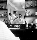 SHAPE NATO Allied Command Europe, Marlais France 1952. Soldier having his haircut - Denise Colomb - 05-04-1952