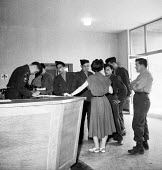 SHAPE NATO Allied Command Europe, Marlais France 1952. Soldiers talking to a young woman in reception area of B Wing - Denise Colomb - 05-04-1952