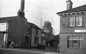 Man with his four young children walking along Front Street, Shotton Colliery, County Durham 1948 - Elisabeth Chat - 1940s,1948,Air Pollution,Air Quality,boy,boys,boys and girls,capitalism,capitalist,child,CHILDHOOD,children,chimney,chimneys,Coal Industry,Coal Mine,coalfield,coalindustry,collieries,colliery,communit