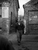 Young miner coming off his shift, Shotton Colliery, County Durham 1948. - Elisabeth Chat - 1940s,1948,capitalism,capitalist,change,Coal Industry,Coal Mine,coalfield,coalindustry,collieries,colliery,coming off,communities,community,EARNINGS,EBF,Economic,Economy,employee,employees,Employment,