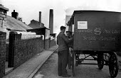 Cooperative Society Provision cart delivering produce to a miner in one of the pit villages of the Durham Coalfields 1948 - Elisabeth Chat - 1940s,1948,Air Pollution,Air Quality,chimney,chimneys,Coal Industry,Coal Mine,coalfield,coalfields,coalindustry,collieries,colliery,commerce,communities,community,Co-Op,Cooperative,co-operative,cooper