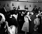 Off duty American GIs from Burtonwood USAF airbase dancing with local women at the Broadway Club, Warrington, 1949. The airbase was reopened in 1948 to support the Cold War through the maintenance and... - Elisabeth Chat - 1940s,1949,ACE,aircraft,Airforce,airman,airmen,American,americans,Armed Forces,club,clubs,culture,dance,dance hall,dancer,dancers,dancing,dress,EMOTION,EMOTIONAL,EMOTIONS,enjoying,enjoyment,fashion,FE