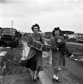 Local women with child visiting Burtonwood USAF airbase near Warrington, 1949. The airbase was reopened in 1948 to support the Wests Cold War effort through the maintenance and overhaul of aircraft in... - Elisabeth Chat - 1940s,1949,adult,adults,aircraft,Airforce,airman,airmen,Armed Forces,babies,baby,child,CHILDHOOD,CHILDREN,EARLY YEARS,EMOTION,EMOTIONAL,EMOTIONS,FAMILY,fashion,FEMALE,HAPPINESS,happy,HAULAGE,HAULIER,H