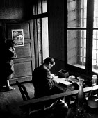 Post war UN World Health Organisation programme Bosnia 1948. 22 year old male nurse Milos Voinovic sets up a clinic in a cafe in the village of Voljevac with nurse Nevenka Konievic putting up a notice... - Eric Schwab - 1940s,1948,Aid Agency,Bosnia,cafe,cafes,care,catering,communities,community,congenital,DESEASE,DESEASES,disease,DISEASES,employee,employees,Employment,HEA,healing,Health,Health Worker,health workers,h