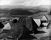 Post war UN World Health Organisation programme Bosnia 1948 A traditional peasant village near Srebenica, Bosnia - Eric Schwab - 1940s,1948,Aid Agency,beauty,Bosnia,communities,community,congenital,country,countryside,DESEASE,DESEASES,HEA,Health,hills,house,houses,housing,ISLAM,ISLAMIC,monotheistic,MUSLEM,Muslim,muslims,outdoor