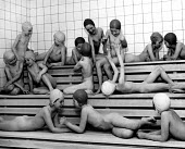 Copenhagen, 1953. Danish school children waiting for their fortnightly school bath in the steam room, Rockild School, Denmark. The regular school bath is one small detail of of a well coordinated syst... - Eric Schwab - 1950s,1953,bathing,bathing hats,care,child,CHILDHOOD,children,cities,City,Danish,EDU,educate,educating,Education,educational,EMOTION,EMOTIONAL,EMOTIONS,female,females,girl,girls,HAPPINESS,happy,HEA,He