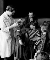 Denmark 1953. Routine inspection for head lice by School nurse, Korsager School, Copenhagen. The free school health services kept Danish schoolchildren amongst the healthiest in the world - Eric Schwab - 19-04-1953