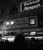 1959 Daily Telegraph displaying General Election results to a crowded Piccadilly Circus, London - Romano Cagnoni - 08-10-1959