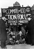 London 1961 Bertrand Russell in a sit down protest by the Committee of 100 Action for Life - for nuclear disarmament, Defence Ministry, Whitehall - Romano Cagnoni - 1960s,1961,activist,activists,anti nuclear,Anti War,Antiwar,atomic,banner,banners,Bertrand Russell,campaign,Campaign for Nuclear Disarmament,campaigning,CAMPAIGNS,cities,City,CND,CND Symbol,Commitee o