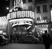 Moulin Rouge cabaret club at night Paris 1961 - Romano Cagnoni - 1960s,1961,AUTO,AUTOMOBILE,AUTOMOBILES,AUTOMOTIVE,cabaret,car,CARS,cities,City,club,clubs,France,French,leisure,LFL,LIFE,lifestyle,light,male,man,men,Moulin Rouge,night,night time,Paris,people,person,