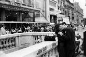Paris 1961 Young couple kissing in the street near the Hotel Colisee and the Franklin D Roosevelt Metro Station - Romano Cagnoni - 1960s,1961,adult,adults,amour,cities,City,couple,COUPLES,embrace,embracing,FEMALE,France,French,Hotel,Hotel Colisee,HOTELS,kiss,kissing,leisure,LFL,LIFE,lifestyle,love,loving,male,man,MATURE,men,Metro
