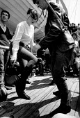 Fashionable young women dancing on deck, Cross Channel Ferry Summer 1962 - Romano Cagnoni - 11-06-1962