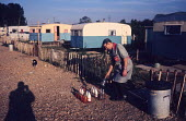Milkman delivering milk to a travellers camp near Slough 1962 - Romano Cagnoni - 11-08-1962