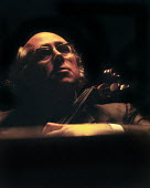 Cellist Mstislav Rostropovich playing in concert, London 1964 - Romano Cagnoni - 1960s,1964,cellist,cello,classical,concert,CONCERTS,London,male,man,melody,men,Mstislav Rostropovich,music,MUSICAL,musical instrument,musical instruments,musician,musicians,people,person,persons,play,