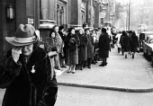 State Funeral of Sir Winston Churchill, London 1965. Woman weeping, queue to view his body Lying in State, Westminster Hall, stretches behind her - Romano Cagnoni - 1960s,1965,bodies,body,ceremonial,ceremonies,ceremony,cities,City,crowd,cry,crying,death,deaths,died,FEMALE,funeral,FUNERALS,fur coat,grief,grieving,hat,honor,honour,line,London,Lying,mortality,mourn,