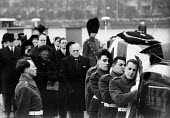 State Funeral of Sir Winston Churchill, London 1965. Lady Clementine Churchill and son Randolph follow the cortege towards the River Thames for his final journey aboard The Havengore - Romano Cagnoni - 1960s,1965,armed forces,army,bearer,bearers,casket,ceremonial,ceremonies,ceremony,cities,City,coffin,coffin bearing,cortege,death,deaths,died,flag,FLAGS,funeral,FUNERALS,grief,honor,honour,honoured,jo
