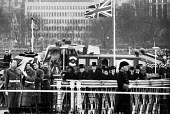 State Funeral of Sir Winston Churchill, London 1965. Lady Clementine Churchill and son Randolph follow the cortege towards the River Thames for his final journey aboard The Havengore - Romano Cagnoni - 1960s,1965,armed forces,army,casket,ceremonial,ceremonies,ceremony,cities,City,Clementine Churchill,coffin,coffin bearing,cortege,death,deaths,died,flag,flags,funeral,FUNERALS,grief,honor,honour,honou